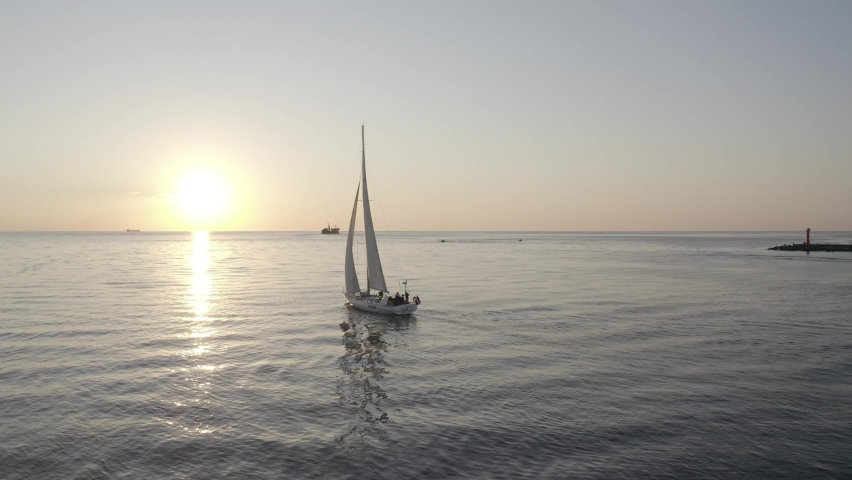 The yacht in the sea goes to meet the sunset | Shutterstock HD Video #1074782696