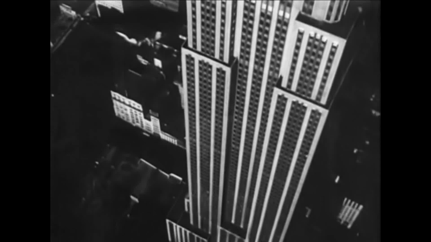 CIRCA 1940 - Excellent aerial footage of New York City skyscrapers, and the Trylon and Perisphere statues at the New York World's Fair.