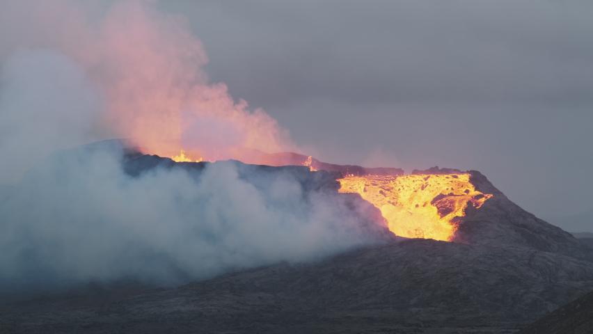 Iceland's newest active volcano, Geldingadalur, erupting   Shutterstock HD Video #1075004099