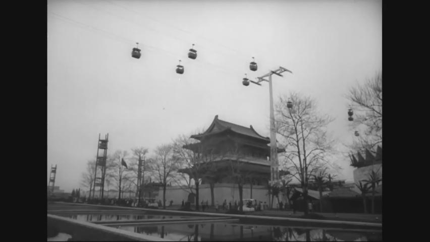 CIRCA 1964 - Visitors walk past pavilions for Hong Kong, Pakistan, Japan, Thailand, India, Berlin, and Hollywood at the New York World's Fair.