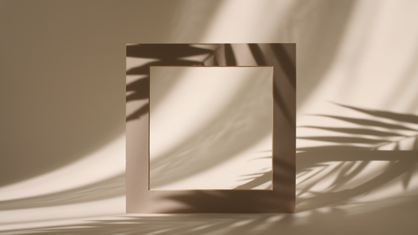 Geometry Frame for Show Product Display on Pastel Beige Background in the Morning Rays of Light and Palm Leaves Shadows. Abstract Minimal Mock up Scene for Product Presentation. Stage Pedestal Royalty-Free Stock Footage #1075675811