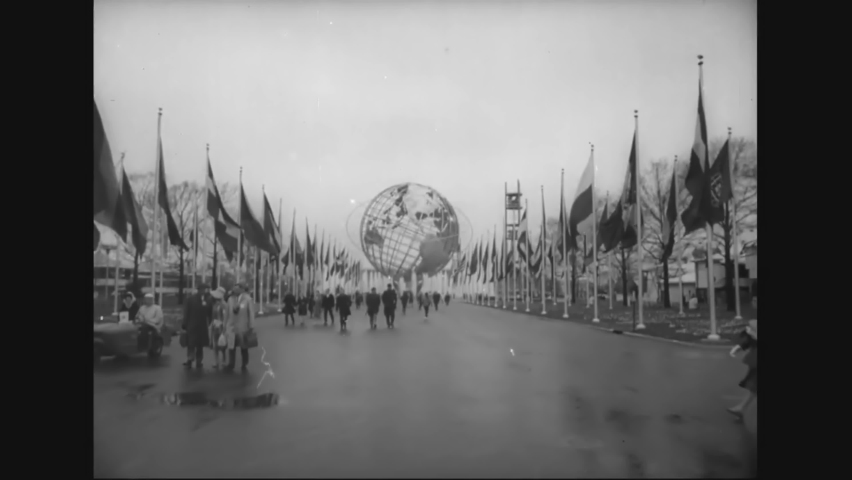 CIRCA 1964 - It rains on opening day of the New York World's Fair, but visitors still arrive and ride the Skyway.