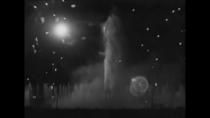 CIRCA 1940 - Fireworks, light shows, and water fountains light up the New York World's Fair when night falls.