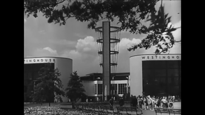 CIRCA 1940 - Pavilions at the New York World's Fair highlight industries of travel, electricity, and technology.
