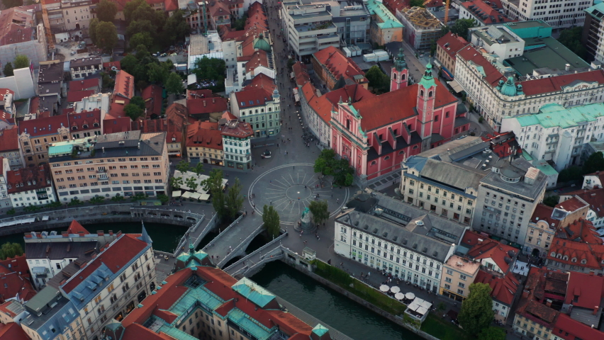 Top View Of Triple Bridge And Franciscan Church In Preseren Square In Ljubljana City Center In Slovenia. aerial Royalty-Free Stock Footage #1075796483