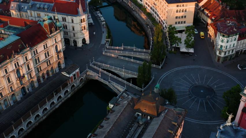 Tromostovje Bridges Over Ljubljanica River And Preseren Square In Ljubljana, Slovenia. ascending drone shot Royalty-Free Stock Footage #1075830158