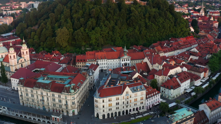 Scenic Sunset View Of Magnificent Old Architecture in Ljubljana In Slovenia - aerial shot Royalty-Free Stock Footage #1075830182
