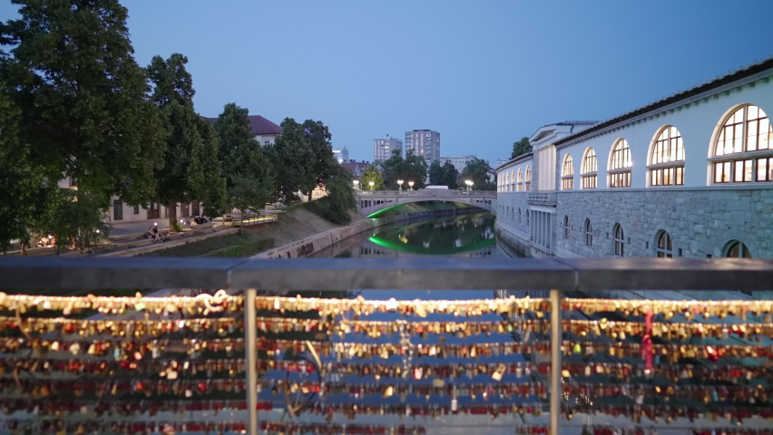 Ljubljana butchers bridge with padlocks over river at night 4K Royalty-Free Stock Footage #1075867184