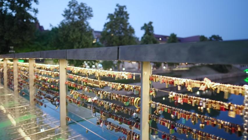 Walk beside the padlock fence butchers bridge in Ljubljana at night 4K Royalty-Free Stock Footage #1075867196