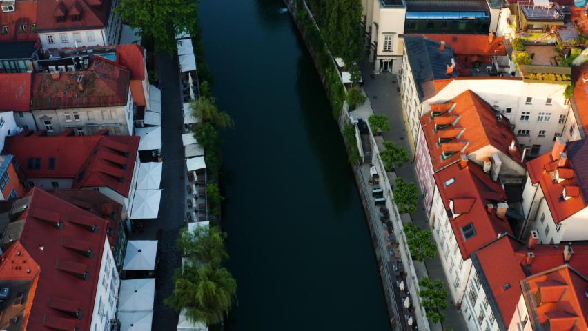 Idyllic Sunrise Over Ljubljana, Slovenia With Aerial View Fishmarket Footbridge Over Ljubljanica River. Royalty-Free Stock Footage #1075968041