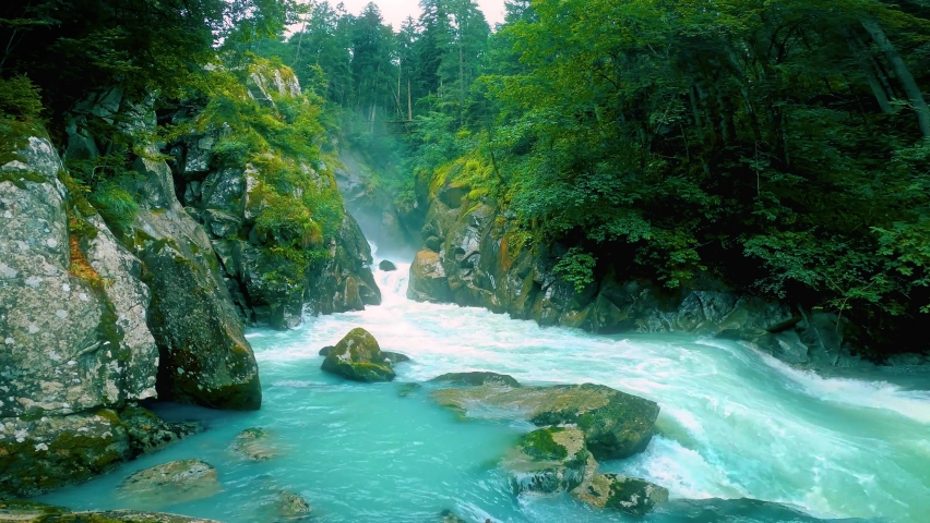 Waterfall and River at Wild Nature. . Waterfall natural sound included. Sport rafting on mountain rivers. Forest rocks with a roaring stream running. Waterfall landscape. Endless video, Loop video. 4K | Shutterstock HD Video #1075976711