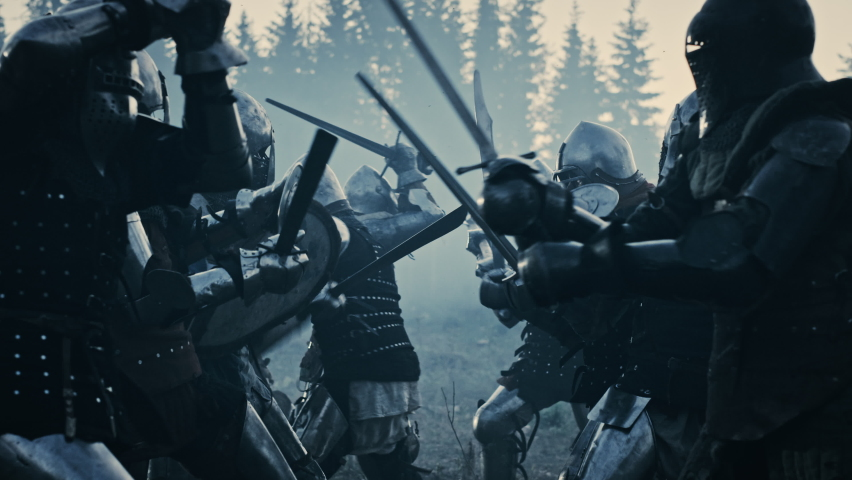 Epic Armies of Medieval Knights on Battlefield Clash, Armored Warriors Fighting Swords. Bloody War, Battle, Invasion. Dramatic Historical Reenactment. Cinematic Blue Light, Slow Motion, Medium Royalty-Free Stock Footage #1076193266