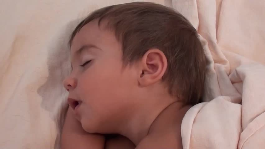 Face of cute toddler sleeping with open mouth    Shutterstock HD Video #10762433