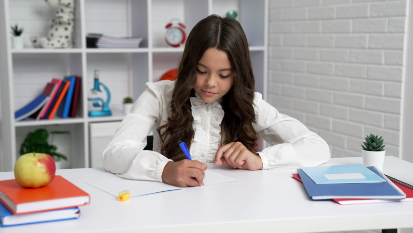 busy teen girl in school uniform writing at lesson, homework Royalty-Free Stock Footage #1076278712