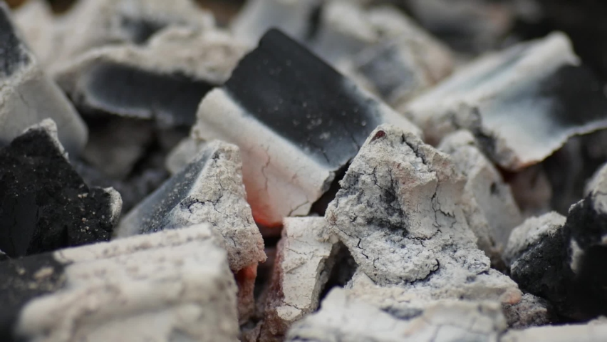 Close-up of smokeless charcoal briquettes for cooking Royalty-Free Stock Footage #1076406179