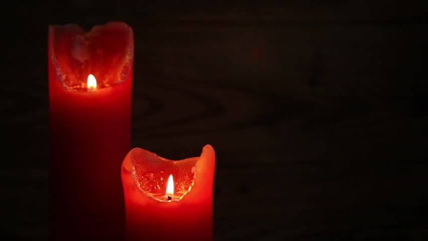 Closeup of red candles on a dark wooden background | Shutterstock HD Video #10765040