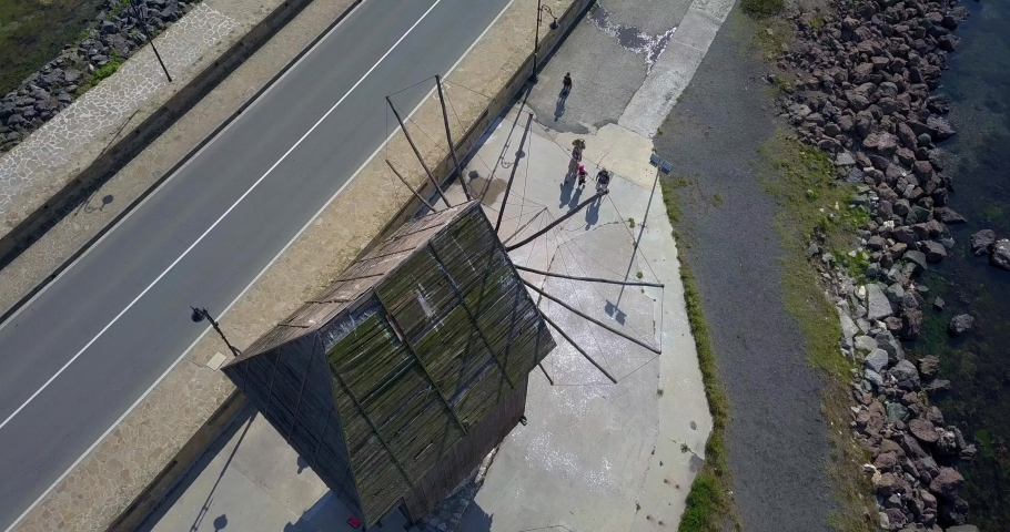 Timelaps. Drone Circling video of the Old windmill in the ancient town of Nesebar in Bulgaria. UNESCO world heritage site.