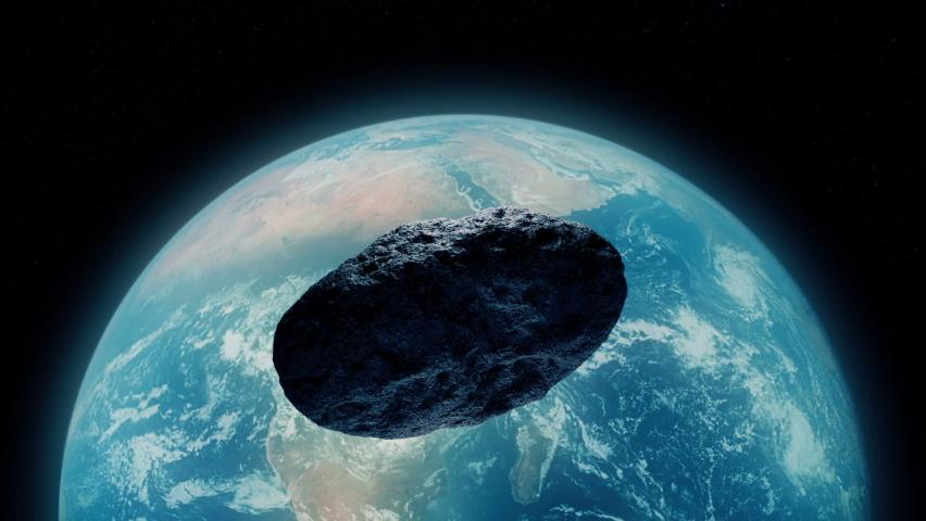 Huge Asteroid Heads Towards Earth   Shutterstock HD Video #1076654135