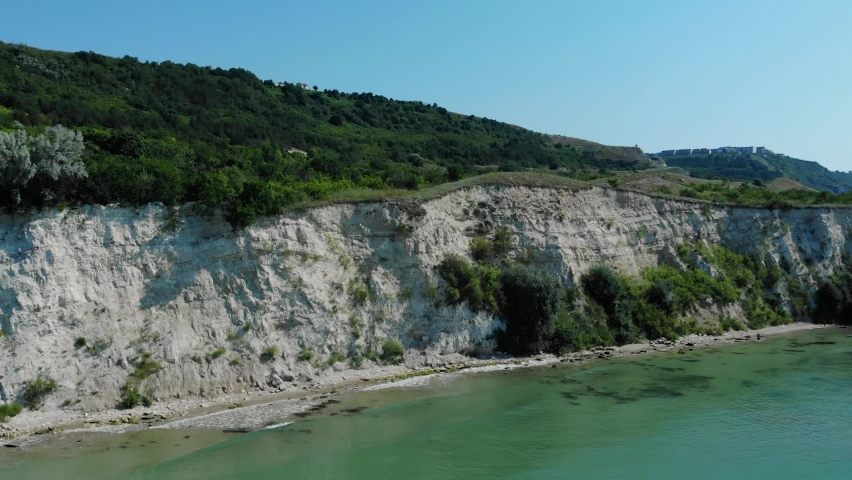 Dense Foliage On White Hills At The Coast Of Black Sea In Balchik, Southern Dobruja, Bulgaria. wide aerial drone   Shutterstock HD Video #1076729453