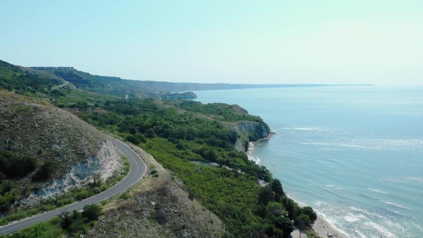 Asphalt Road On Rugged Shoreline Of Heros Beach In The Town Of Balchik, Black Sea Coast, Bulgaria. aerial   Shutterstock HD Video #1076735552