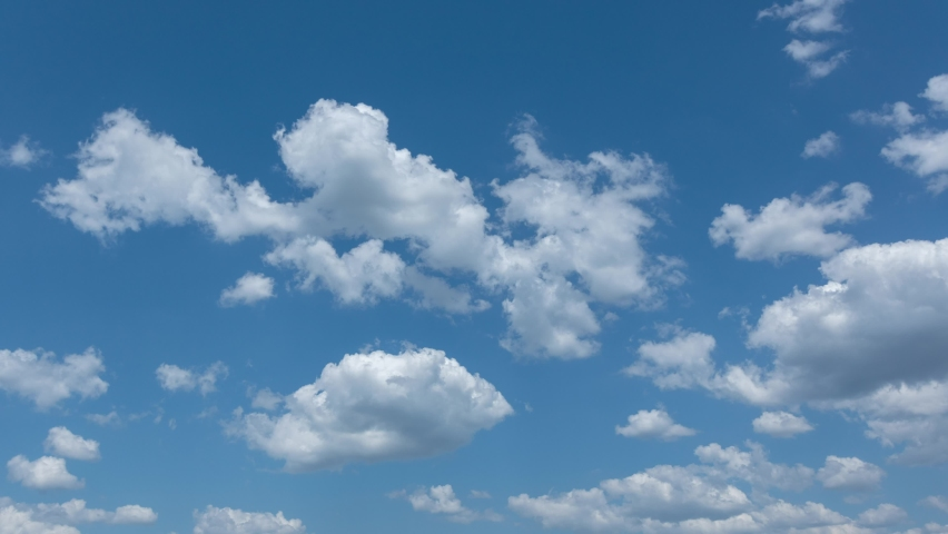 Beautiful perfect peaceful 4k video timelapse of scenic small white clouds flying in sunny blue sky. Natural abstract background | Shutterstock HD Video #1076794931