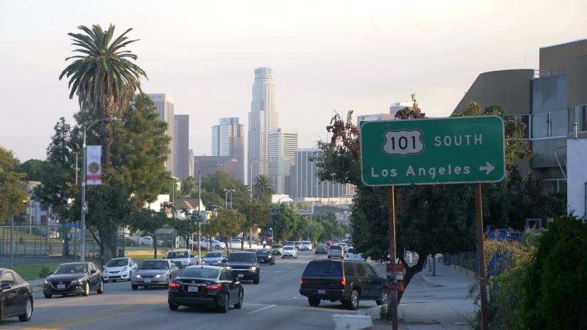 Street in Los Angeles with downtown view | Shutterstock HD Video #1076823386