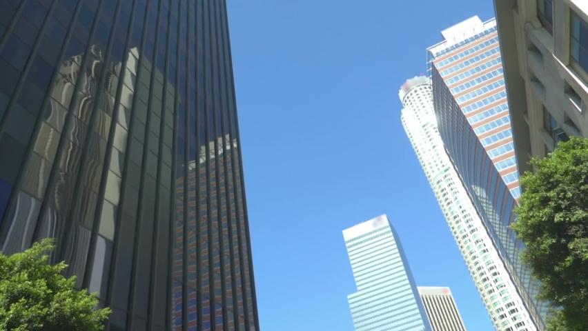 Car POV on skyscrapers in Los Angeles in slow motion | Shutterstock HD Video #1076823593