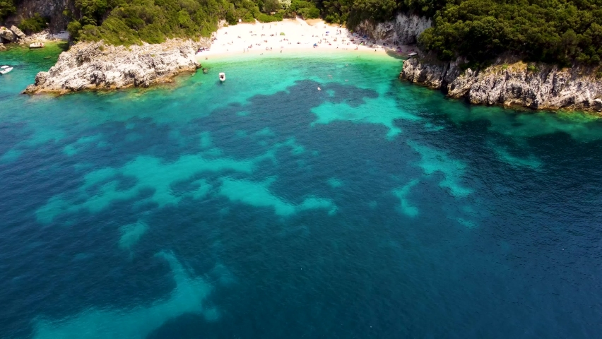 Drone video of Rovinia beach near Palaiokastritsa and Liapades, Corfu island. Beautiful drone video of greek beach on Corfu island, Greece.   Shutterstock HD Video #1076845163