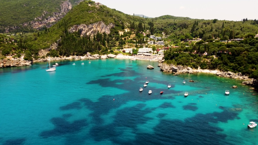 Aerial view of Liapades beach on Corfu island, Greece.    Shutterstock HD Video #1076895185