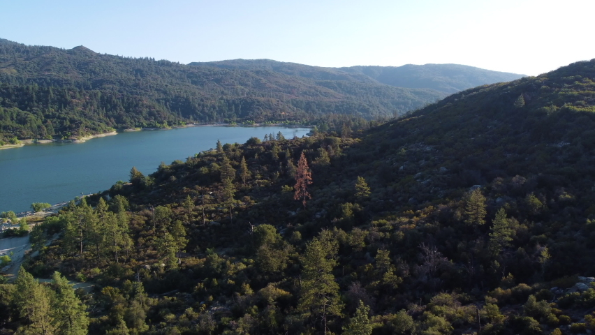 Majestic landscape of lake Hemet surrounded by forestry mountains, aerial view | Shutterstock HD Video #1076916215