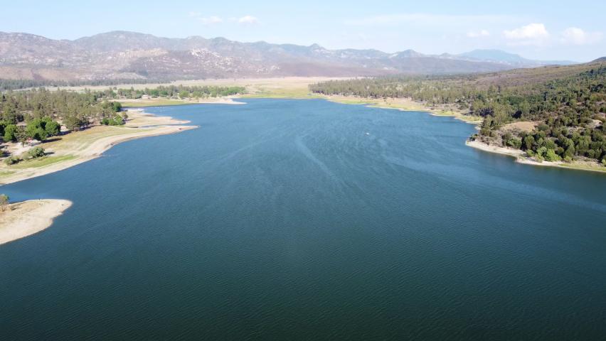 Majestic landscape of lake Hemet, California. Drone ascending view | Shutterstock HD Video #1076916791