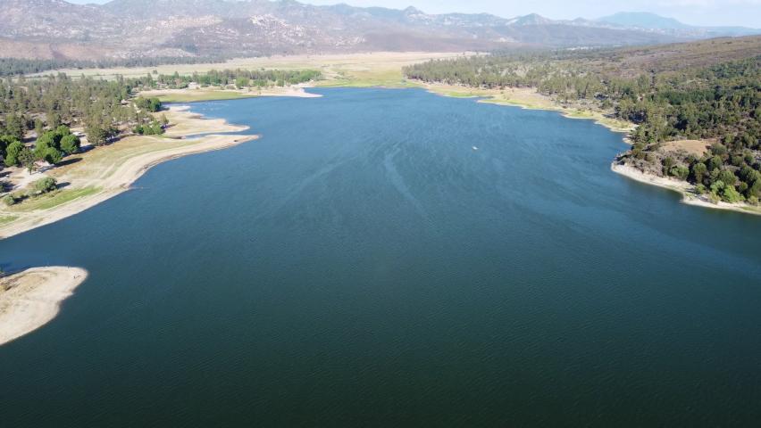 Vast lake Hemet and beautiful mountain range in horizon, aerial view | Shutterstock HD Video #1076916797