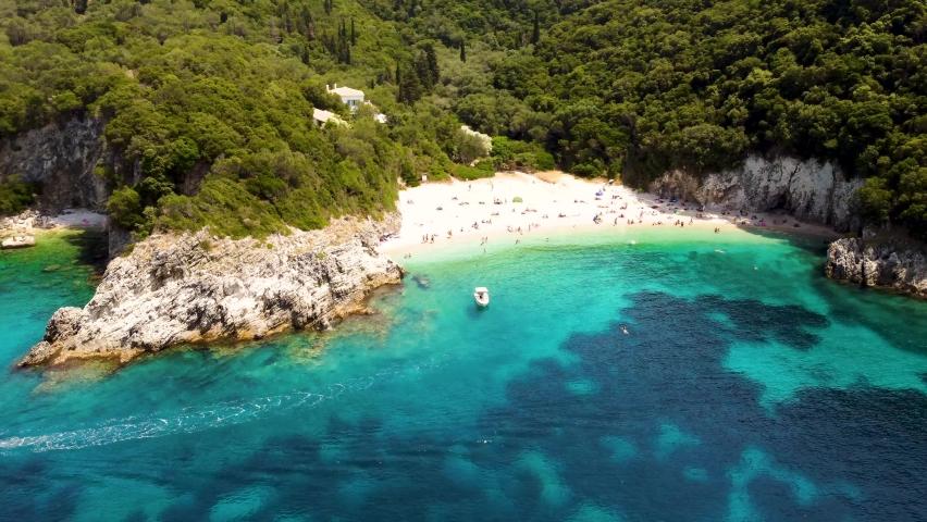 Drone footage of Rovinia beach near Palaiokastritsa and Liapades, Corfu island. Beautiful aerial video of greek beach on Corfu island, Greece.   Shutterstock HD Video #1077028490