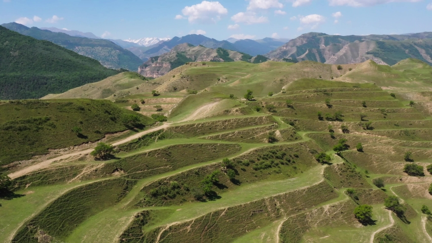 Top view on the green agricultural fields in countryside ,mountains valley at sunlight, beautiful rural scene with green fields | Shutterstock HD Video #1077075962