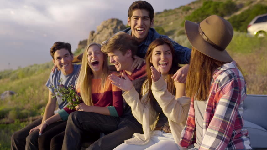 Group Of Happy Teens Laugh Really Hard, Their Friend Surprises Them And Hugs Them, They Laugh More (Slow Motion)
