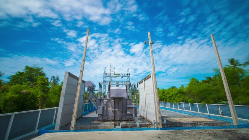 4k timelapse of Power transformer  with blue sky cloud move over the electrical substation