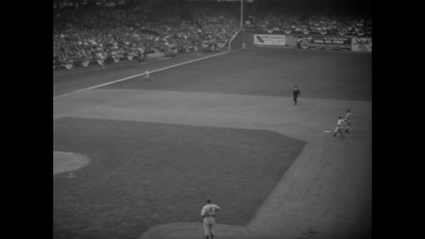 CIRCA 1941 - Charley Stanceu pitches in a baseball game at Ebbets Field between the Brooklyn Dodgers and the New York Yankees.