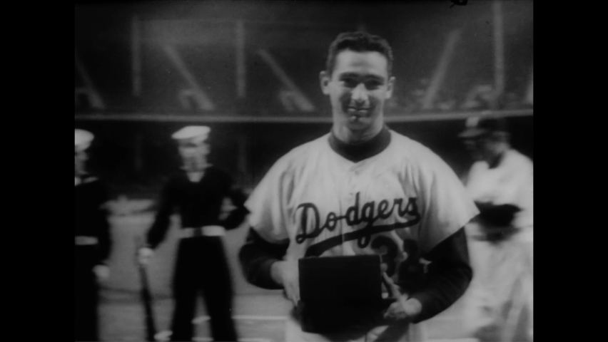 CIRCA 1957 - Roy Campanella, Sandy Koufax and other Brooklyn Dodgers are honored by the National Conference of Christians and Jews at Ebbets Field.