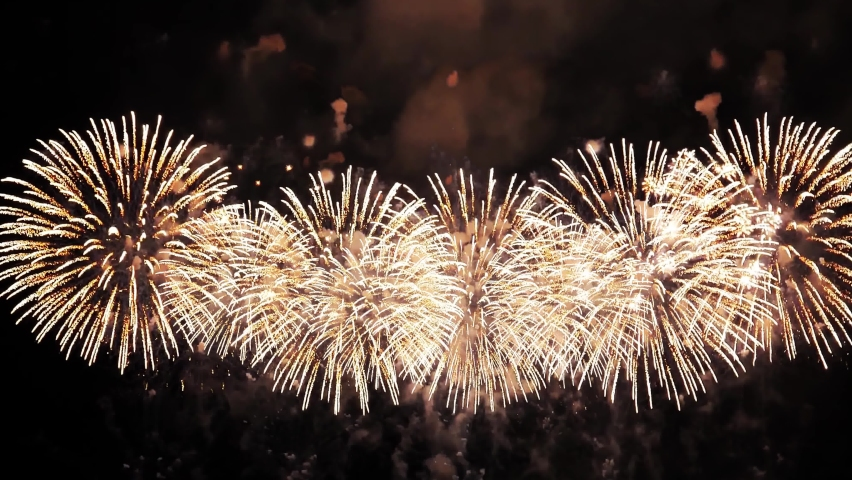 4K. loop seamless of real fireworks background. abstract blur of real golden shining fireworks with bokeh lights in the night sky. glowing fireworks show. New year's eve fireworks celebration   Shutterstock HD Video #1078435091
