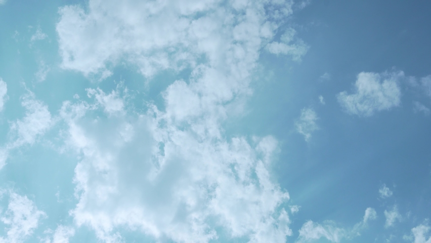 White Cumulus Clouds in the Sun's Rays in the Blue Sky, Time Lapse. Background of White Clouds and Blue Sky.Sunny Cloudy Weather. Climate, Atmosphere, Air Layers, Nitrogen Layer Altitude Air Cloud 4K