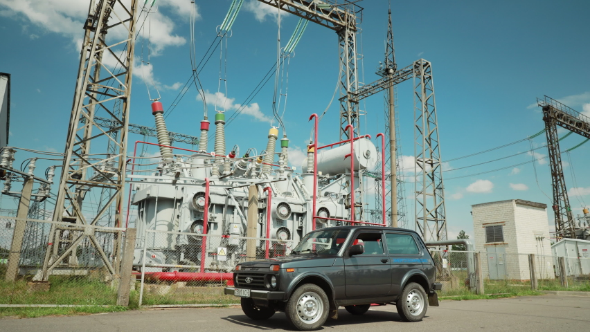 Gomel, Belarus: August 11, 2021: Service Car Parked At Power Grid Station. Electrical Distribution Station, Transformers, High-voltage Lines In Sunny Summer Day. Time Lapse, Timelapse, Time-lapse, 4K.