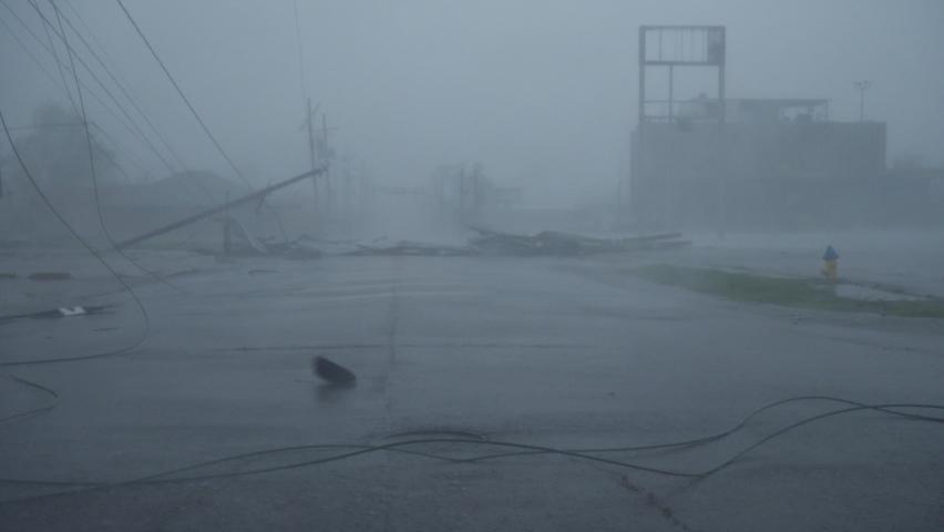 Houma, Louisiana USA - August 29 2021: Hurricane Ida Blows Debris Past Toppled Power Poles