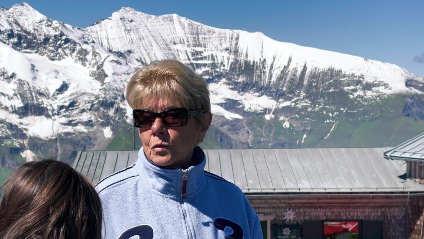 Happy family looking at wonderful alpin landscape in summer season | Shutterstock HD Video #1079274881