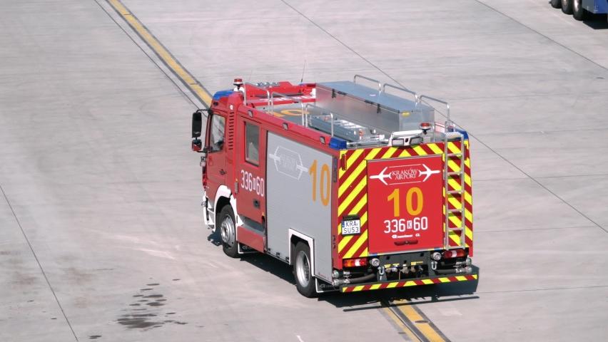 BALICE, POLAND - SEPTEMBER 11, 2021: Fire engine truck Mercedes-Benz Atego 1530 Rosenbauer CL - LSRG. Rapid intervention car at the John Paul II Kraków-Balice International Airport.