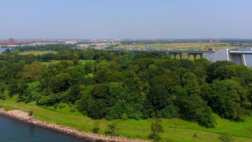 This video shows scenic aerial views of Ferry Point Park near the  Whitestone Bridge in the Bronx.  | Shutterstock HD Video #1079566844