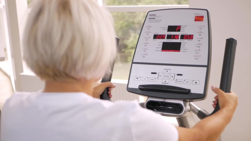Rehabilitation center gym, recovery from injuries and fractures. an elderly woman perform an exercise on the simulator. Healthy lifestyle, concept senior, pensioner. close up   Shutterstock HD Video #1080822809
