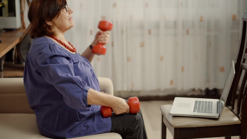 Senior Woman Exercising On Home   Shutterstock HD Video #1080833513