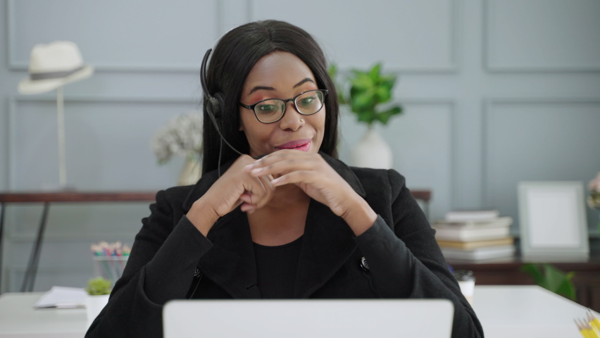 African-American woman call center was consulting with clients  | Shutterstock HD Video #1080836552