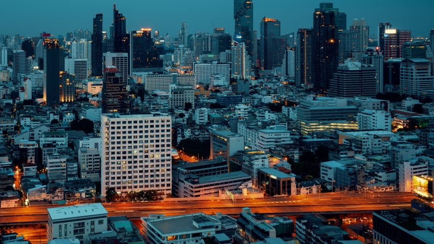 Time lapse night cityscape and high-rise buildings in metropolis city center . Downtown business district in panoramic view .   Shutterstock HD Video #1080907916