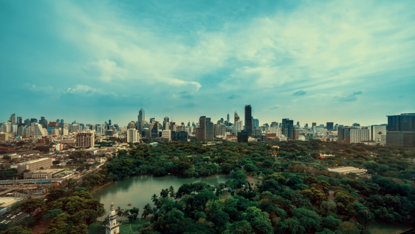 Time lapse public park and high-rise buildings cityscape in metropolis city center . Green environment city and downtown business district in panoramic view .   Shutterstock HD Video #1080966992